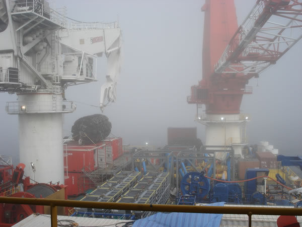 Fog obscures the view of the Arkutun-Dagi GBS from the vantage point of the Lewek Crusader. Photo by F. Kredensor