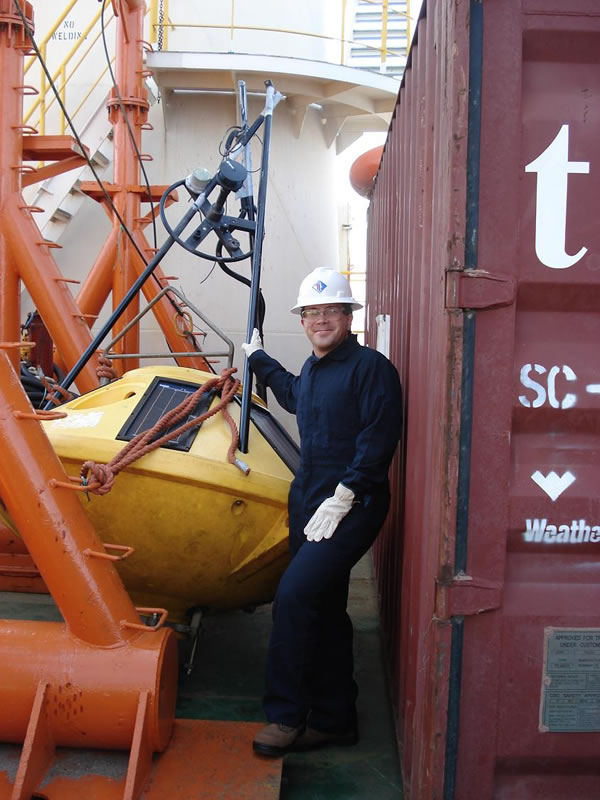 WWT meteorologist Francis Kredensor with recovered weather buoy.